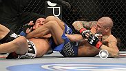 Dustin Poirier transitions through his triangle choke to finish Max Holloway with an impressive mounted triangle armbar at UFC 143.
