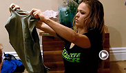 Ronda Rousey stops by the TUF house to show the fighters how to fashionably cut and shred their workout shirts.