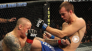 After hurting TUF 9 winner Ross Pearson with a flurry of punches, TUF 5 contestant Cole Miller jumps on the back of 'The Real Deal' and sinks in the rear-naked choke.
