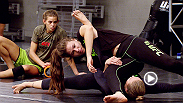 Women's bantamweight champion Ronda Rousey instructs TUF 18 contestants on how to pull off her ever-effective armbar. Rousey, winner of seven straight by submission, looks to continue her impressive streak against rival Miesha Tate at UFC 168.