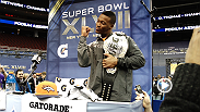 UFC correspondent Megan Olivi makes her way through the chaos of Super Bowl media day with the a UFC champion belt. See various NFLers pose with the belt and Regis Philbin's challenge to Ricardo Lamas.