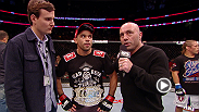 Bantamweight champion Renan Barao and his opponent Urijah Faber talk to Joe Rogan after Barao TKOd Faber in the first round of their UFC 169 main event.