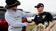 "UFC fighter Donald ""Cowboy"" Cerrone presents the UFC belt to Kevin Harvick as a good luck token for the Daytona 500."
