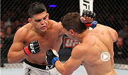 Undefeated welterweight Kelvin Gastelum hurts opponent Brian Melancon with a crisp combination before locking in a rear-naked choke.
