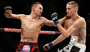 Max Holloway gets back on track following back-to-back losses with this second-round finish of 6-foot-4 featherweight Will Chope. Holloway takes on Charles Oliveira at Fight Night Saskatoon on FOX Sports 1.