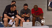 Eddie Gordon sits with Team Edgar coaches to review Cathal Pendred's fight against Hector Urbina.