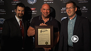 Mayor of Bangor, Maine, Ben Sprague, gives UFC president Dana White a Proclamation of Thanks for his efforts in the community and bringing the UFC back to the New England area.