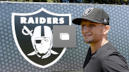 Bantamweight champion T.J. Dillashaw visits the Oakland Raiders football facility during UFC 177 fight week.