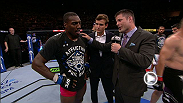 UFC commentator Brian Stann speaks with UFC 179 co-main event winner Phil Davis in the Octagon after his victory over Glover Teixeira.
