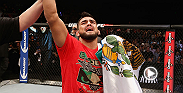 Kelvin Gastelum speaks to UFC color commentator Joe Rogan immediately following his big first-round submission win against UFC veteran Jake Ellenberger at UFC 180.