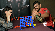 Welterweight contender Kelvin Gastelum sits down with UFC correspondent Megan Olivi to play a game of Connect Four and talk about his upcoming fight against Tyron Woodley at UFC 183.