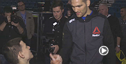 Ahead of UFC 194, Chris Weidman surprises Ian Matuszak, a fan who has cerebral palsy, by having him join his team for the walkouts on fight night against Luke Rockhold.