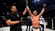 Friends Stephen Thompson and Rory MacDonald talk in the Octagon after Thompson defeated MacDonald at Fight Night Ottawa by unanimous decision.
