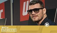 Michael Bisping and Dan Henderson play to the fans at open workouts. Later that night, Opponents Gegard Mousasi and Vitor Belfort both tempt themselves at very different stores. On Thursday, all the guys make their way to media day.