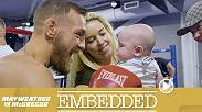 Conor McGregor signs a fan's cast before enjoying another hard sparring session in the boxing ring. Floyd Mayweather courts his fans at a Mayweather vs. McGregor pop-up shop. McGregor brings his baby to work with him at the UFC Performance Institute.