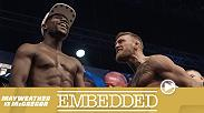 Fans pack T-Mobile Arena, and headliners Conor McGregor and Floyd Mayweather arrive with their entourages. The megastars hit the scale for the official weigh-in and then face off in one final, intense staredown before the next day's superfight.