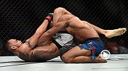 Tony Ferguson celebrates in the Octagon after defeating Kevin Lee for the interim lightweight title at UFC 216.