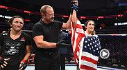 Tatiana Suarez meets with Joe Rogan in the Octagon after a dominant win over former strawweight champ Carla Esparza at UFC 228: Woodley vs Till.