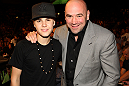 (L-R) Singer Justin Bieber and UFC President Dana White poses for a photo Octagonside at UFC 132.
