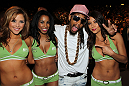 Rapper Lil Jon poses with UFC Octagon Girls (L-R) Brittney Palmer, Chandella Powell and Arianny Celeste at UFC 132.