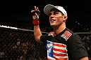 Dominick Cruz celebrates his win over Urijah Faber.