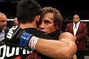 Dominick Cruz and Urijah Faber after the main event fight.