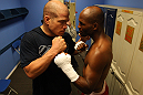 (R-L) World Champion boxer Bernard Hopkins and former UFC champion Tito Ortiz pose for a photo in the locker room at the Joe Hand Gym