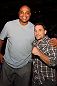UFC 133: Director Stephen Sebring and designer Reed Krakoff pose for a photo octagonside.