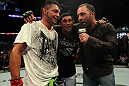 Leonard Garcia, Nam Phan and Joe Rogan after the fight