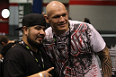 UFC fighter Krzysztof Soszynski poses for a photo with a fan at the UFC Fan Expo