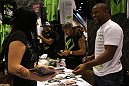 UFC Fighters Clay Guida and Rashad Evans signs autographs for fans