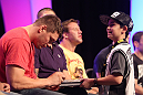 Matt Mitrione signs an autograph for a young fan during a Q&amp;A session at the UFC Fan Expo
