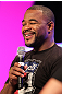 UFC fighter Rashad Evans attends a Q&A session with former cast members of The Ultimate Fighter on the main stage at the UFC Fan Expo