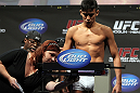 SAN JOSE, CA - NOVEMBER 18:  Miguel Angel Torres weighs in during the UFC 139 Weigh In at the HP Pavilion on November 18, 2011 in San Jose, California.  (Photo by Josh Hedges/Zuffa LLC/Zuffa LLC via Getty Images)