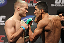 SAN JOSE, CA - NOVEMBER 18:  (L-R) Bantamweight opponents Michael MacDonald and Alex Soto face off after weighing in during the UFC 139 Weigh In at the HP Pavilion on November 18, 2011 in San Jose, California.  (Photo by Josh Hedges/Zuffa LLC/Zuffa LLC via Getty Images)