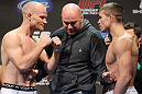 SAN JOSE, CA - NOVEMBER 18:  (L-R) Welterweight opponents Martin Kampmann and Rick Story are separated by UFC president Dana White as they face off after weighing in during the UFC 139 Weigh In at the HP Pavilion on November 18, 2011 in San Jose, California.  (Photo by Josh Hedges/Zuffa LLC/Zuffa LLC via Getty Images)