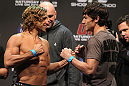 SAN JOSE, CA - NOVEMBER 18:  (L-R) Bantamweight opponents Urijah Faber and Brian Bowles face off after weighing in during the UFC 139 Weigh In at the HP Pavilion on November 18, 2011 in San Jose, California.  (Photo by Josh Hedges/Zuffa LLC/Zuffa LLC via Getty Images)