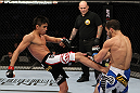 SAN JOSE, CA - NOVEMBER 19: (L-R) Miguel Torres kicks Nick Pace during an UFC Bantamweight bout at the HP Pavillion in San Jose, California on November 19, 2011 in San Jose, California.  (Photo by Josh Hedges/Zuffa LLC/Zuffa LLC via Getty Images)