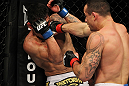 SAN JOSE, CA - NOVEMBER 19: (L-R) Gleison Tibau punches Rafael dos Anjos during an UFC Lightweight bout at the HP Pavilion in San Jose, California on November 19, 2011 in San Jose, California. (Photo by Josh Hedges/Zuffa LLC/Zuffa LLC via Getty Images)