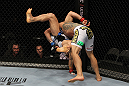 SAN JOSE, CA - NOVEMBER 19:  (R-L)Rafael dos Anjos slams Gleison Tibau to the mat during an UFC Lightweight bout at the HP Pavillion in San Jose, California on November 19, 2011 in San Jose, California.  (Photo by Josh Hedges/Zuffa LLC/Zuffa LLC via Getty Images)