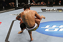 SAN JOSE, CA - NOVEMBER 19: (L-R) Gleison Tibau slams Rafael dos Anjos to the mat during an UFC Lightweight bout at the HP Pavillion on November 19, 2011 in San Jose, California.  (Photo by Josh Hedges/Zuffa LLC/Zuffa LLC via Getty Images)