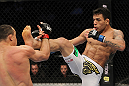 SAN JOSE, CA - NOVEMBER 19: (R-L) Rafael dos Anjos kicks Gleison Tibau during an UFC Lightweight bout at the HP Pavillion in San Jose, California on November 19, 2011 in San Jose, California.  (Photo by Josh Hedges/Zuffa LLC/Zuffa LLC via Getty Images)