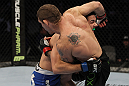 SAN JOSE, CA - NOVEMBER 19: Chris Weidman takes down Tom Lawlor to the mat during an UFC Middleweight bout at the HP Pavilion on November 19, 2011 in San Jose, California. (Photo by Josh Hedges/Zuffa LLC/Zuffa LLC via Getty Images)
