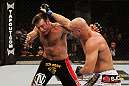 SAN JOSE, CA - NOVEMBER 19: (L-R) Stephan Bonnar dodges the punch of Kyle Kingsbury during an UFC Light Heavywieght bout at the HP Pavillion on November 19, 2011 in San Jose, California.  (Photo by Josh Hedges/Zuffa LLC/Zuffa LLC via Getty Images)