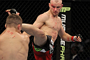 SAN JOSE, CA - NOVEMBER 19: (R-L) Martin Kampmann kicking Rick Story during an UFC Welterweight bout at the HP Pavillion on November 19, 2011 in San Jose, California. (Photo by Josh Hedges/Zuffa LLC/Zuffa LLC via Getty Images)