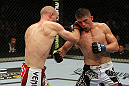 SAN JOSE, CA - NOVEMBER 19:  (L-R) Martin Kampmann punches Rick Story during an UFC Welterweight bout at the HP Pavillion on November 19, 2011 in San Jose, California.  (Photo by Josh Hedges/Zuffa LLC/Zuffa LLC via Getty Images)