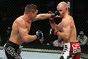 SAN JOSE, CA - NOVEMBER 19:  (L-R) Rick Story punches Martin Kampmann during an UFC Welterweight bout at the HP Pavillion on November 19, 2011 in San Jose, California.  (Photo by Josh Hedges/Zuffa LLC/Zuffa LLC via Getty Images)