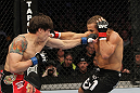 SAN JOSE, CA - NOVEMBER 19:  (L-R) Brian Bowles punches Urijah Faber during an UFC Bantamweight bout at the HP Pavillion  on November 19, 2011 in San Jose, California.  (Photo by Josh Hedges/Zuffa LLC/Zuffa LLC via Getty Images)