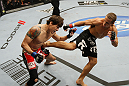 SAN JOSE, CA - NOVEMBER 19: (R-L) Urijah Faber kicks Brian Bowles in the side during an UFC Bantamweight bout at the HP Pavillion on November 19, 2011 in San Jose, California.  (Photo by Josh Hedges/Zuffa LLC/Zuffa LLC via Getty Images)