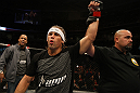 SAN JOSE, CA - NOVEMBER 19: Urijah Faber celebrates defeating Brian Bowles during an UFC Bantamweight bout at the HP Pavillion on November 19, 2011 in San Jose, California.  (Photo by Josh Hedges/Zuffa LLC/Zuffa LLC via Getty Images)
